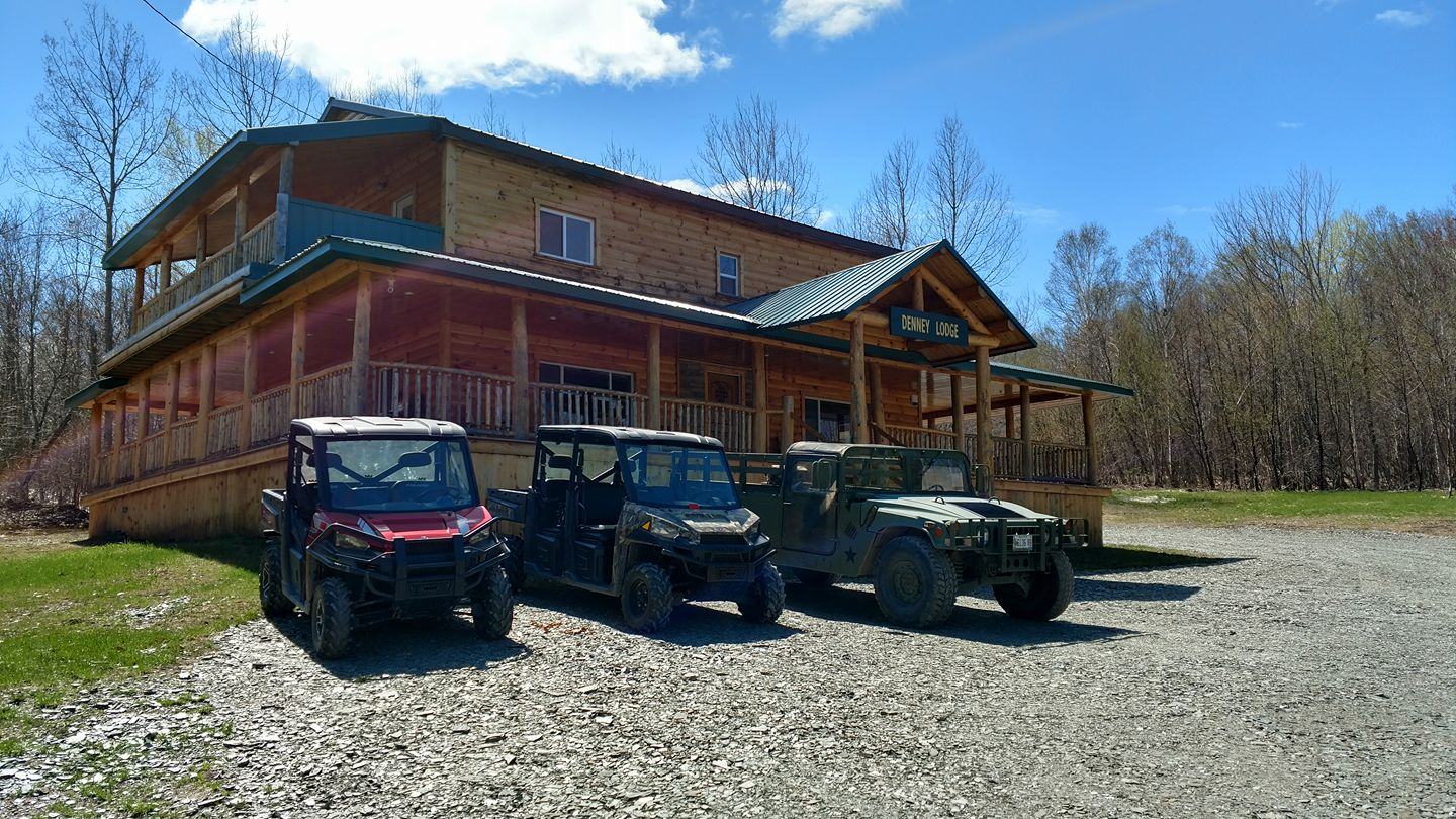 denney lodge with ATVs out front